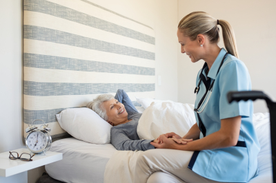 nurse with senior woman at home