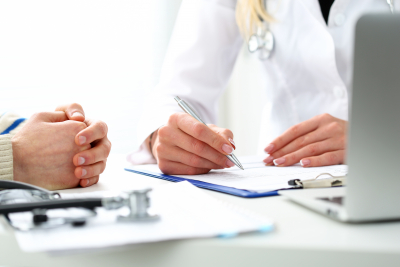 doctor hold silver pen filling patient history list