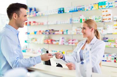 pharmacist and customer at pharmacy,