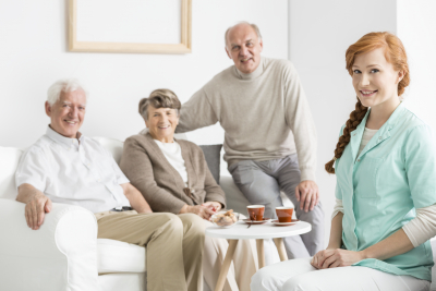 young caregiver and her patients in nursing home